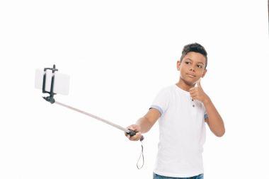 african american boy taking selfie