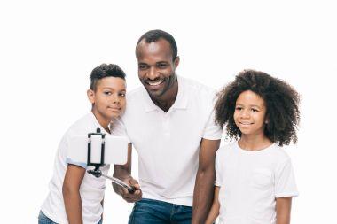 african american family taking selfie