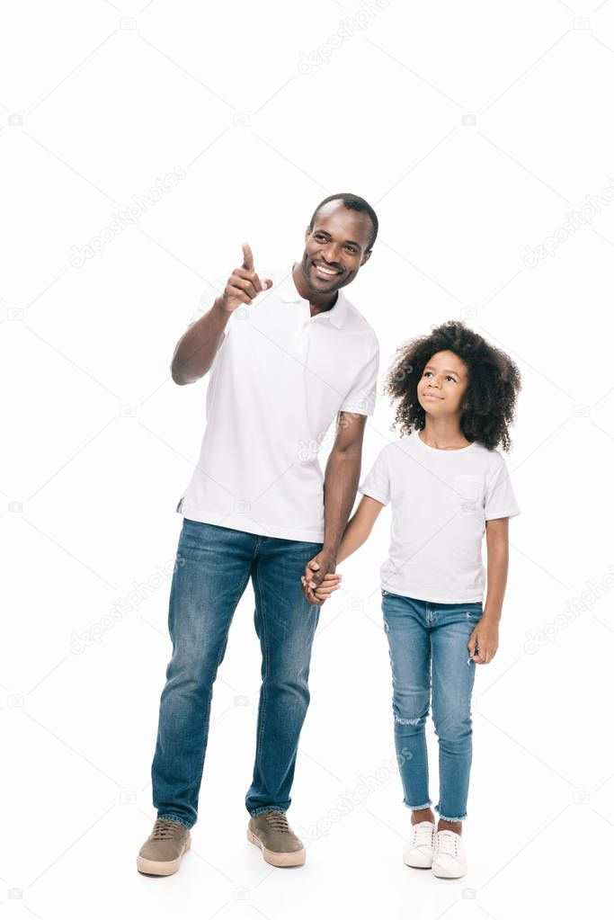 father with daughter pointing away