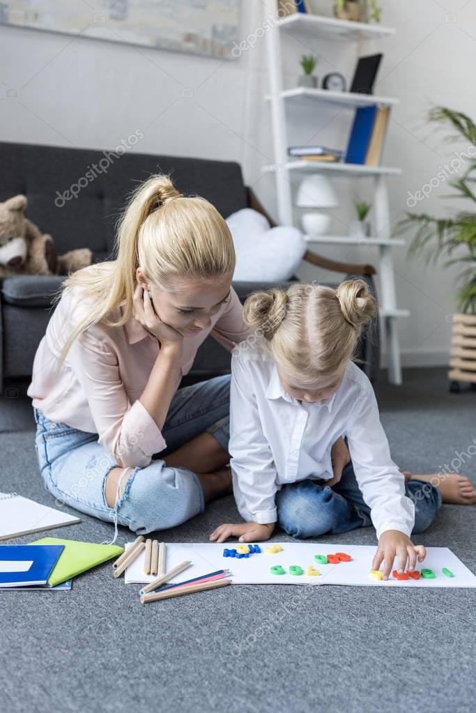 mother and daughter learning mathematics