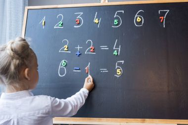 child studying numbers