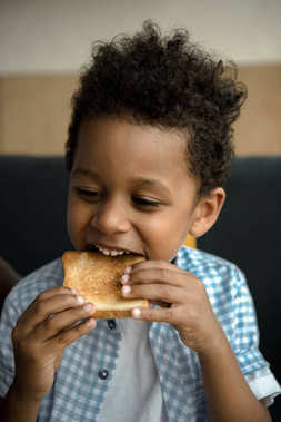 african american child eating toast
