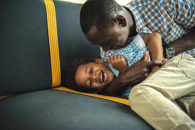 african american father and son having fun