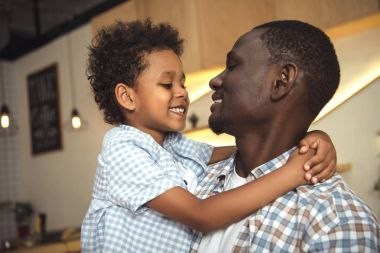 African american father and child hugging