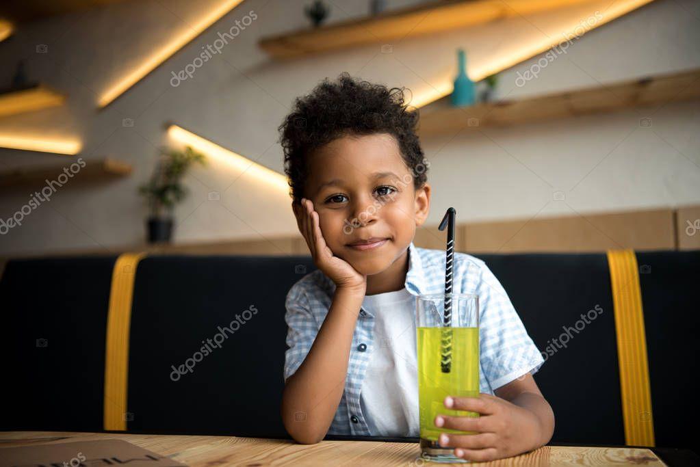 african american child drinking lemonade