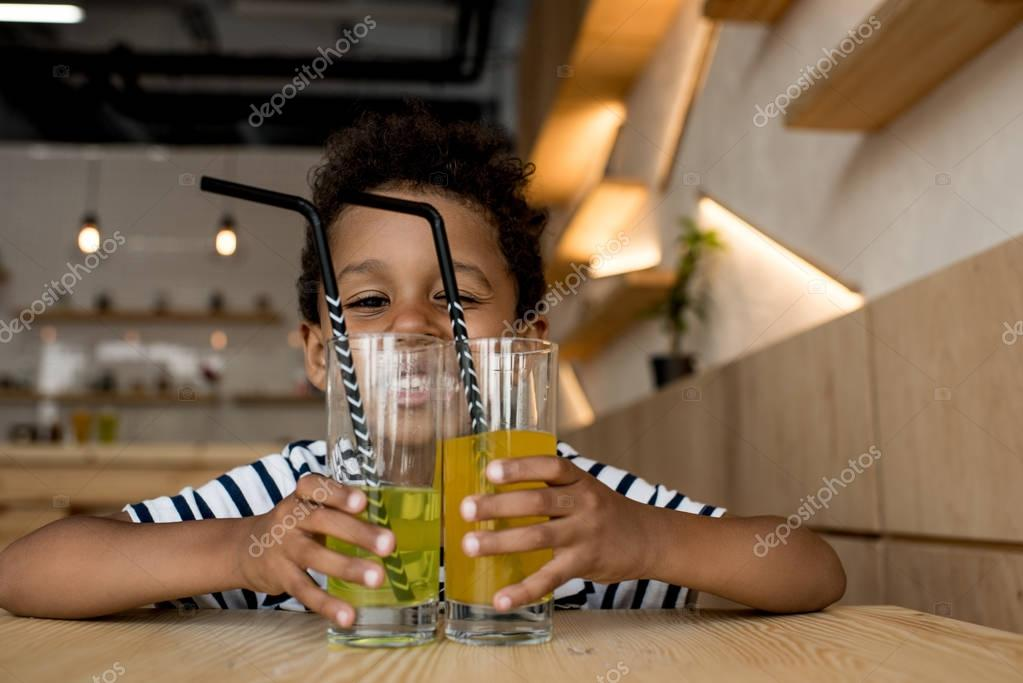 african american child with glasses on juice