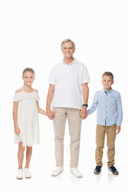 Grandfather and grandchildren holding hands