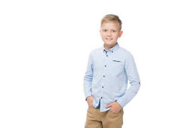 Portrait of smiling caucasian little boy with hands in pocket looking at camera isolated on white stock vector