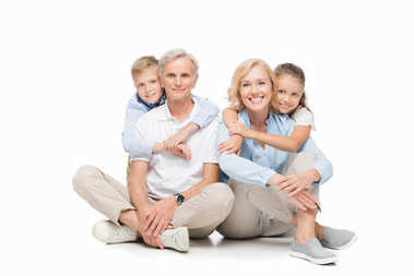 Smiling children hugging grandparents and looking at camera isolated on white stock vector