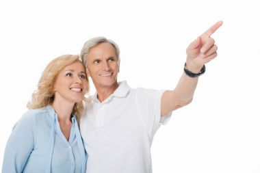 mature couple pointing away with finger