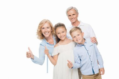 grandparents and grandchildren showing thumbs up