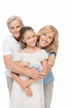 Happy grandparents with granddaughter hugging and smiling at camera isolated on white stock vector
