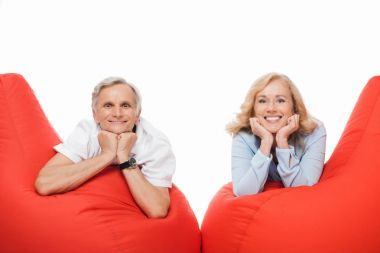 mature couple on bean bag chairs