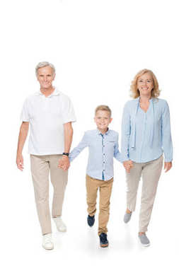 Grandparents with grandchild holding hands
