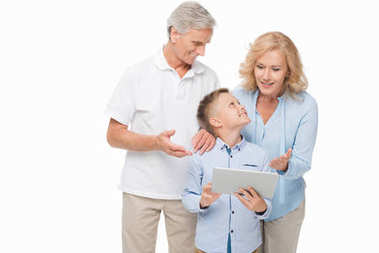Boy and grandparents with tablet