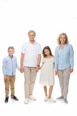 grandparents and kids holding hands