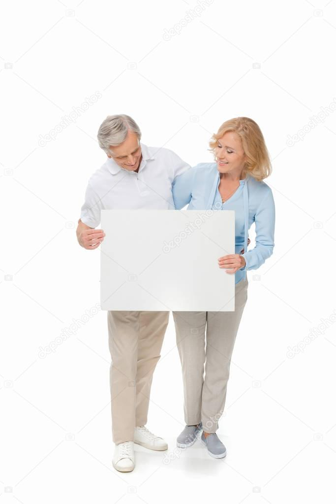 senior couple with empty card