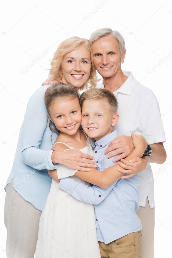 Grandparents with grandchildren hugging