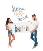 Photo Attractive couple with banner