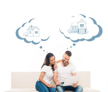Young attractive couple using laptop, dreaming about own home, isolated on white stock vector