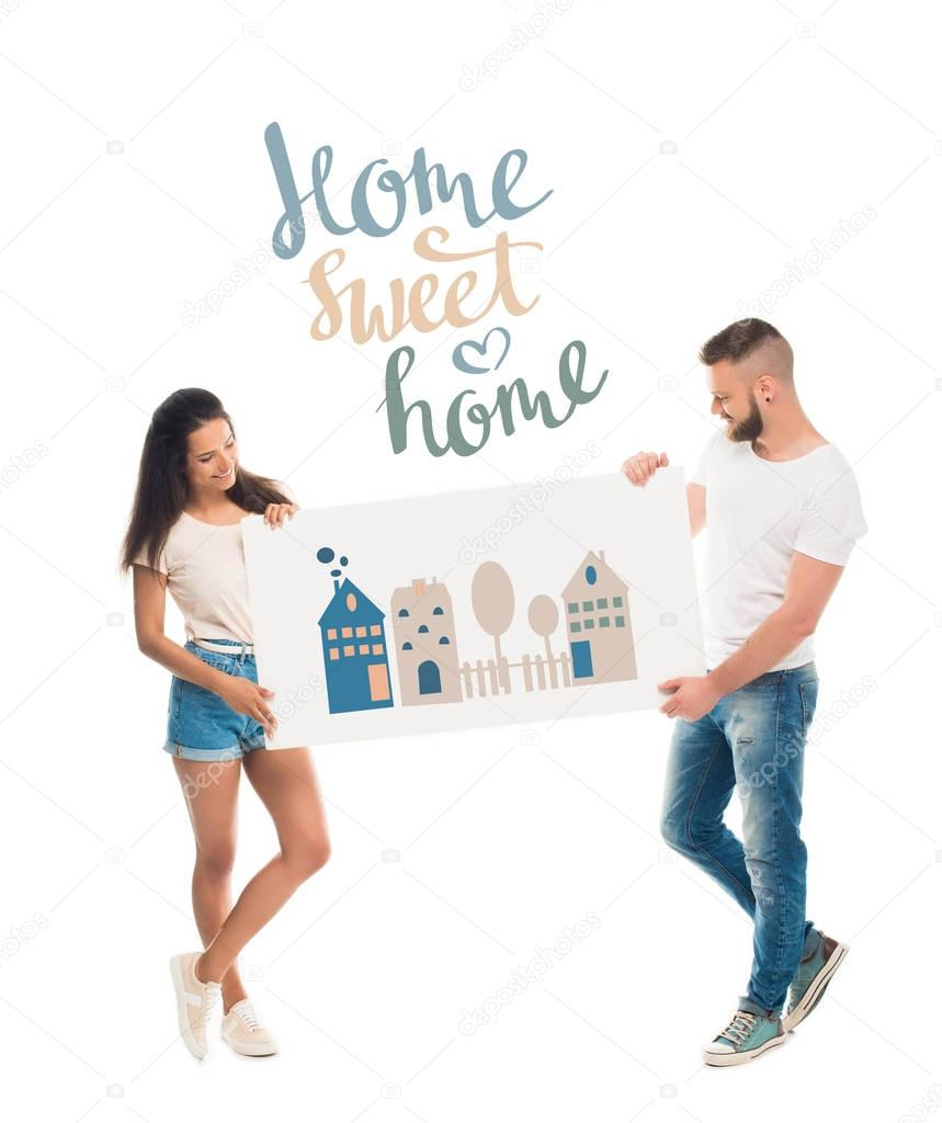 Attractive couple with banner