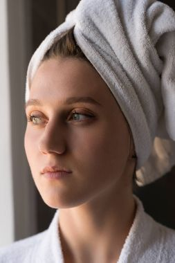 Girl with towel on head