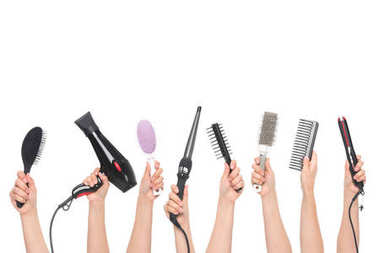 Cropped shot of human hands holding hairdressing tools isolated on white stock vector