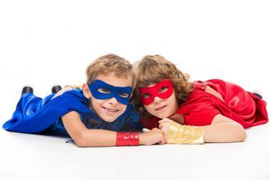 boys in superhero costumes