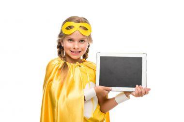 supergirl with digital tablet