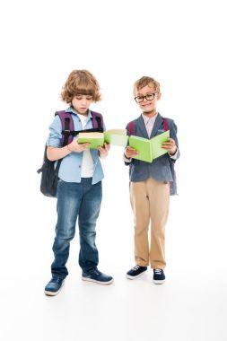 Schoolboys reading books