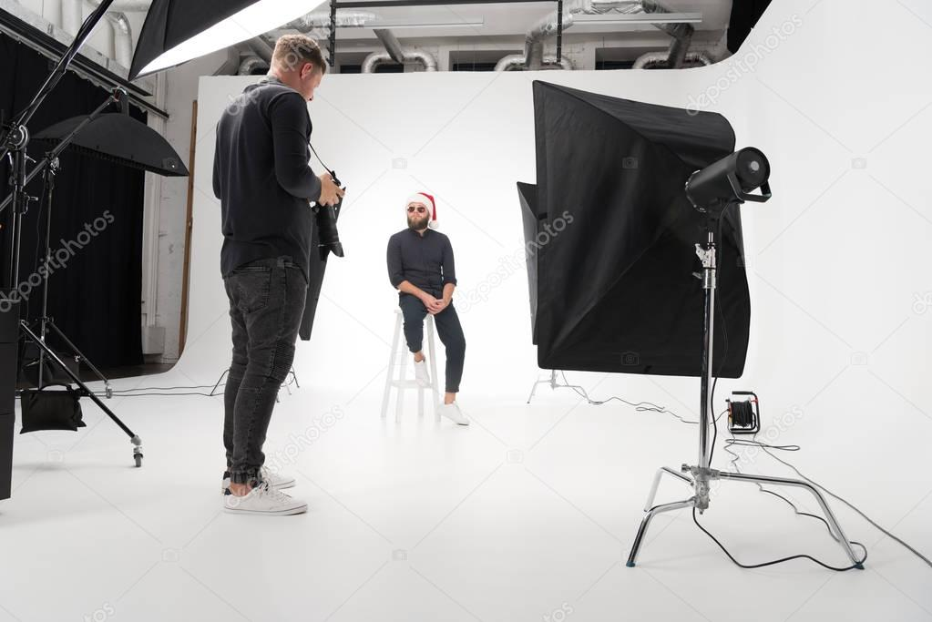 Photographer working in studio with model