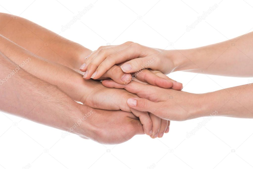 people stacking hands