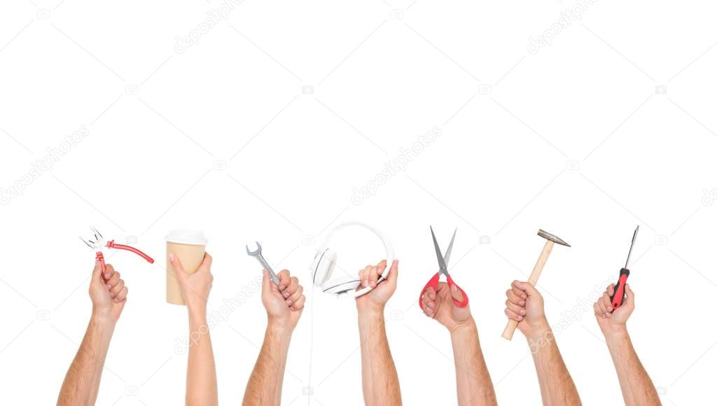 hands holding tools and objects