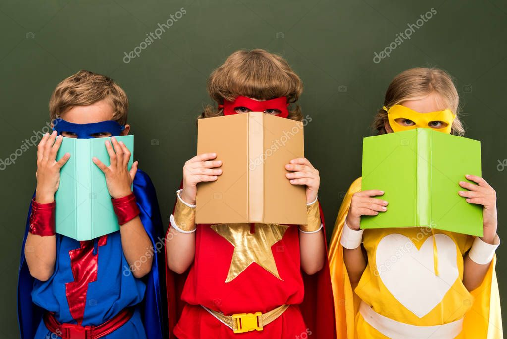 little superheroes with books