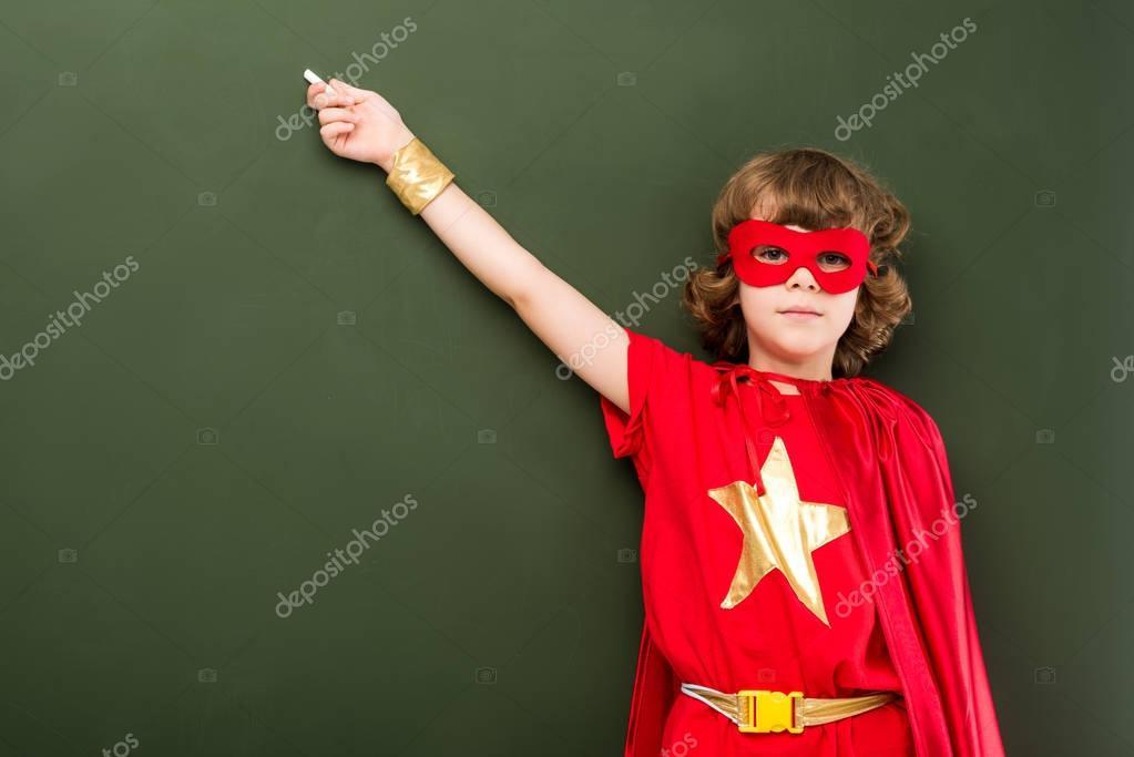 superhero pointing on chalkboard