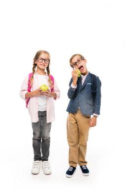schoolchildren eating apples