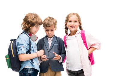schoolchildren using smartphone