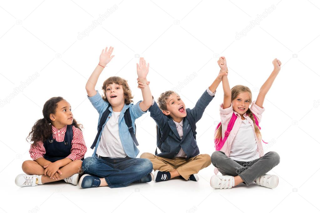 excited multiethnic schoolchildren