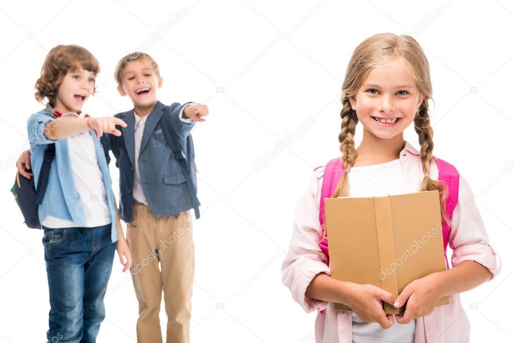 pupils laughing at schoolgirl