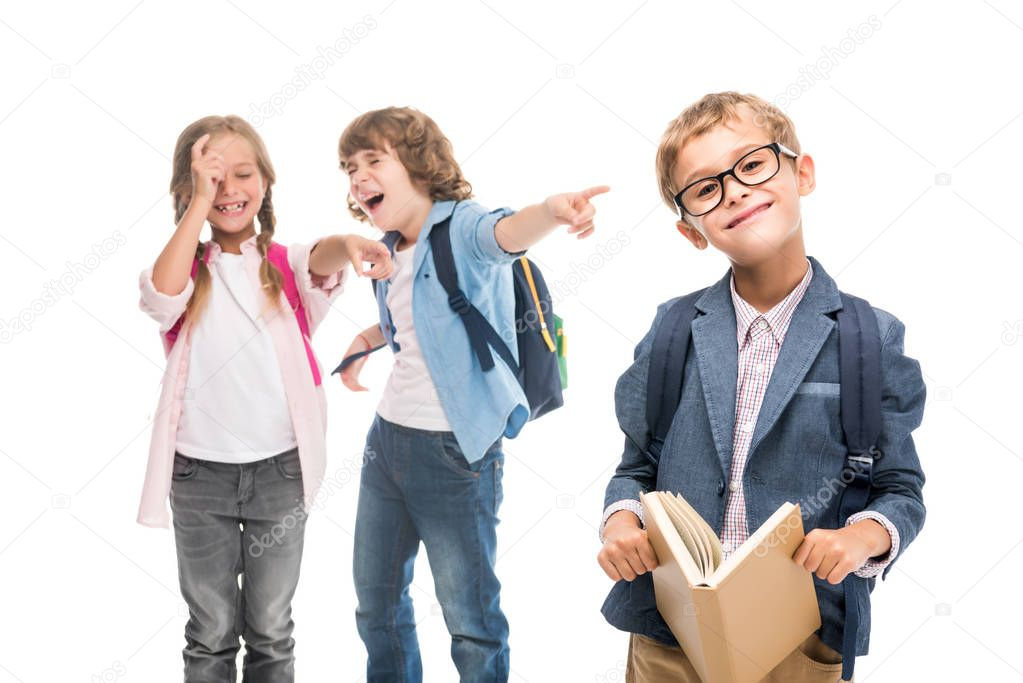 classmates laughing at schoolboy