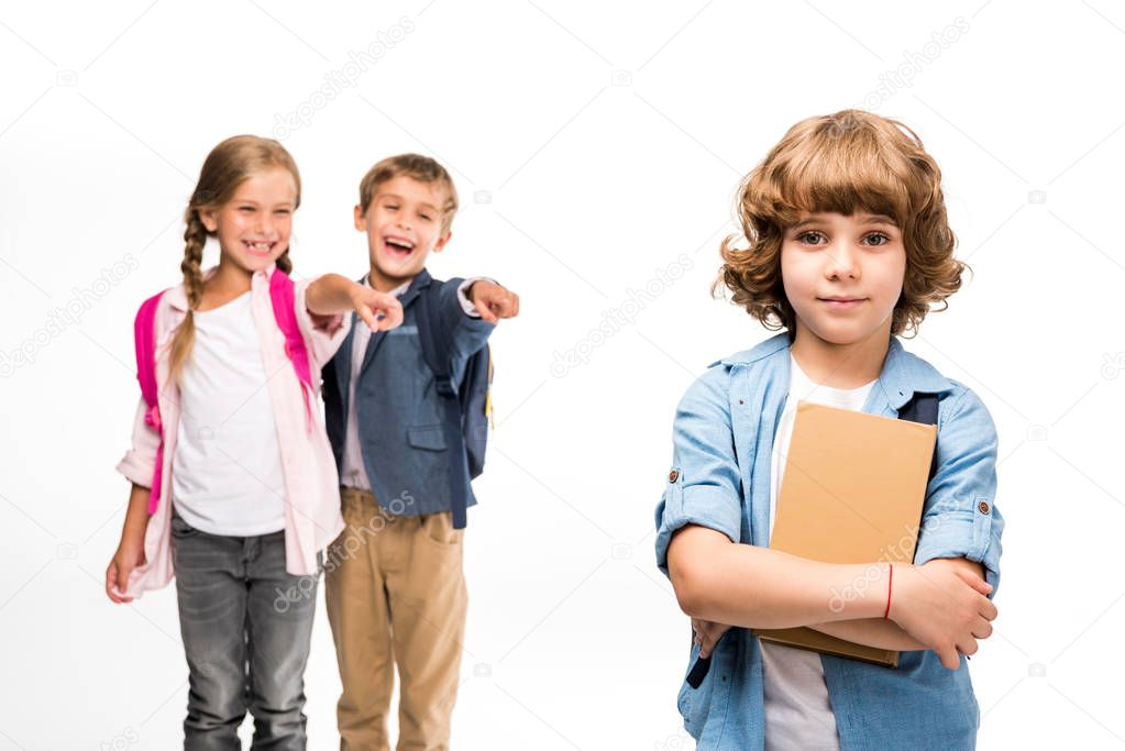 pupils laughing at schoolboy