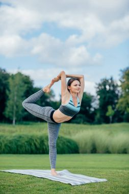 fit woman performing yoga