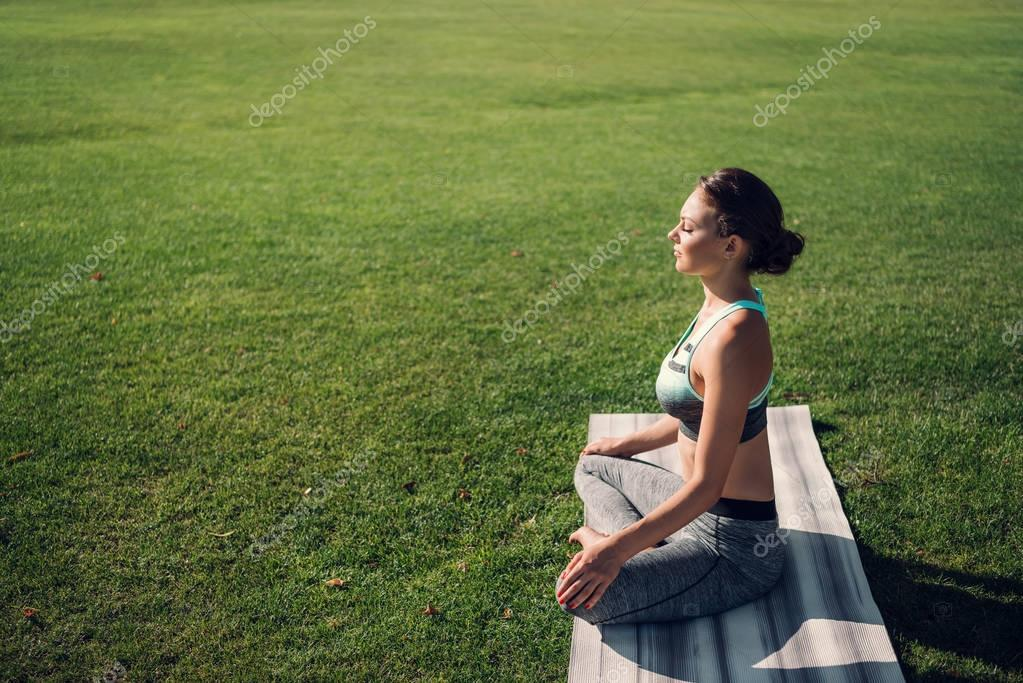 caucasian woman practicing lotus pose