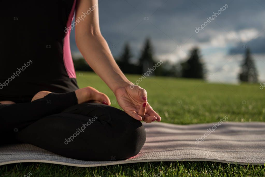 woman practicing lotus pose