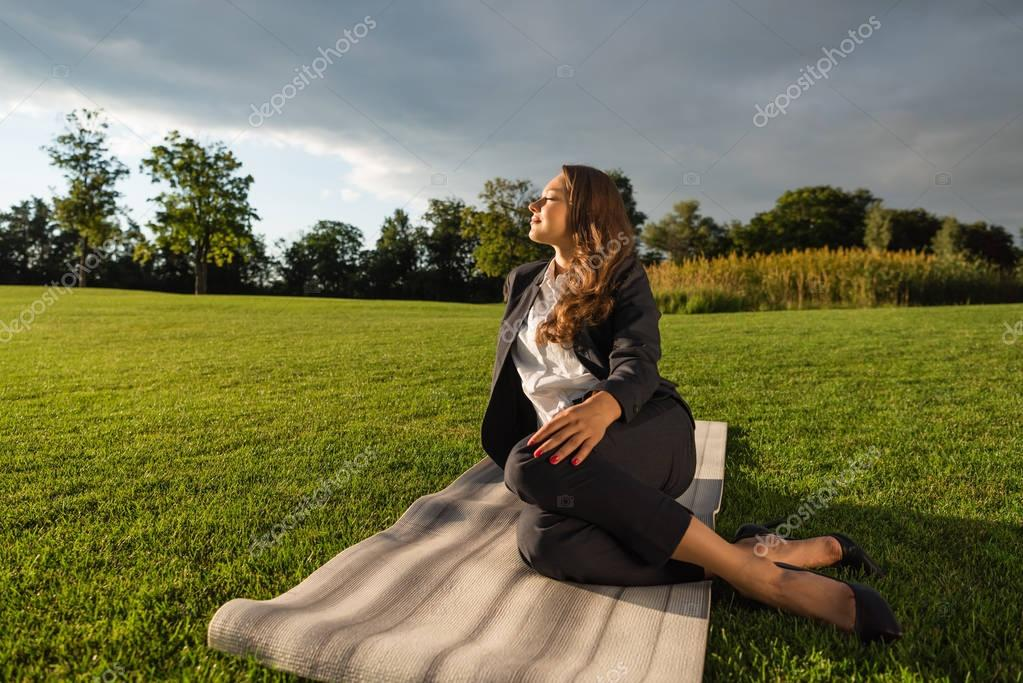 businesswoman resting in park