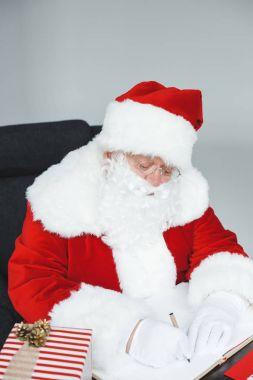 santa claus sitting in armchair