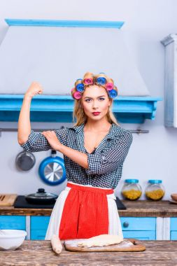 strong housewife in kitchen