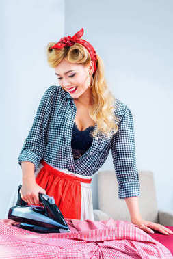housewife ironing laundry