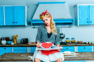 housewife reading cookbook