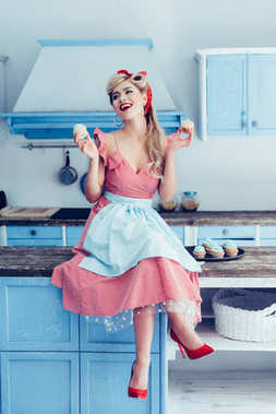 pin up housewife with cupcakes